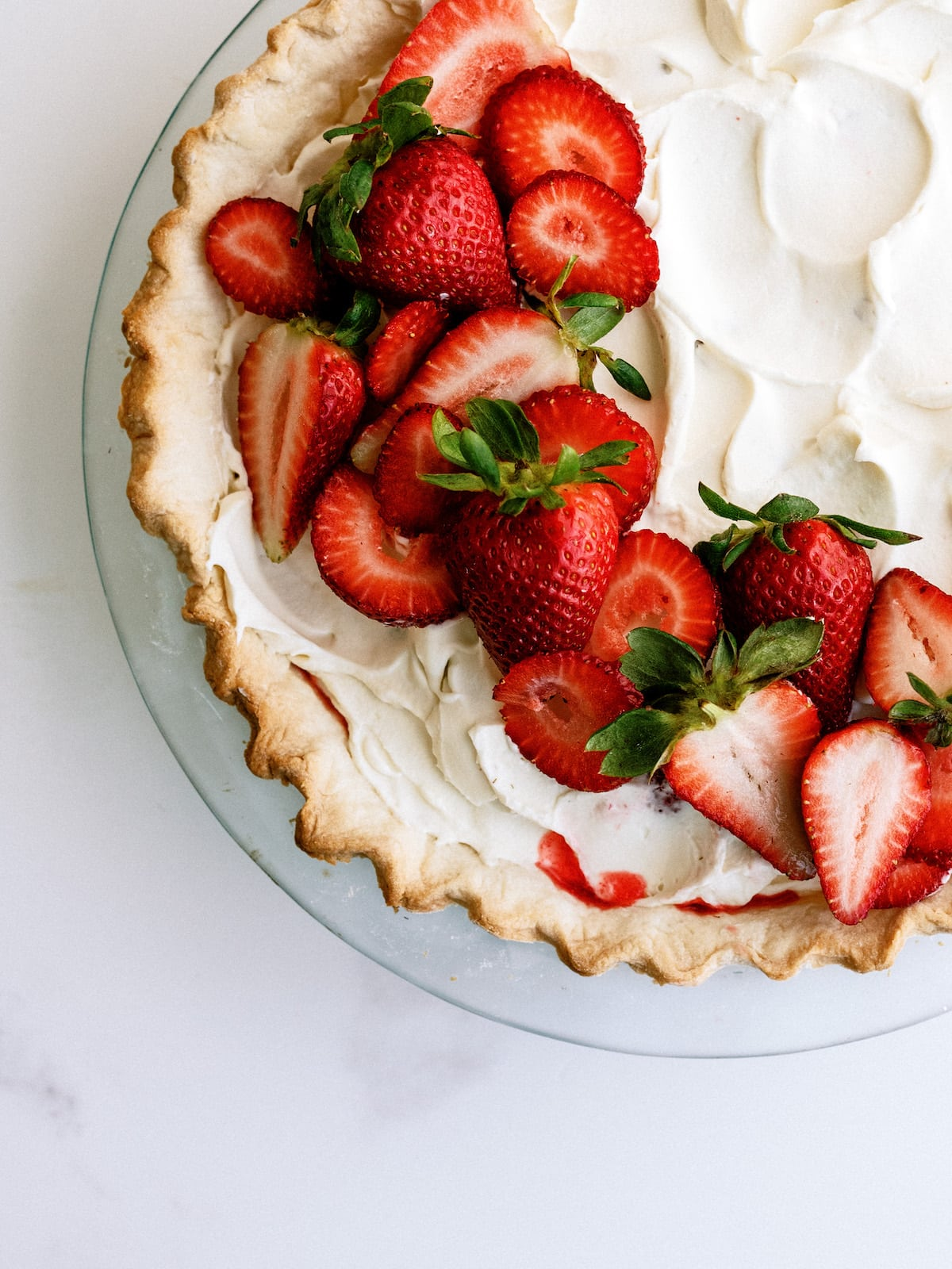strawberry pie with jello and whipped cream on top