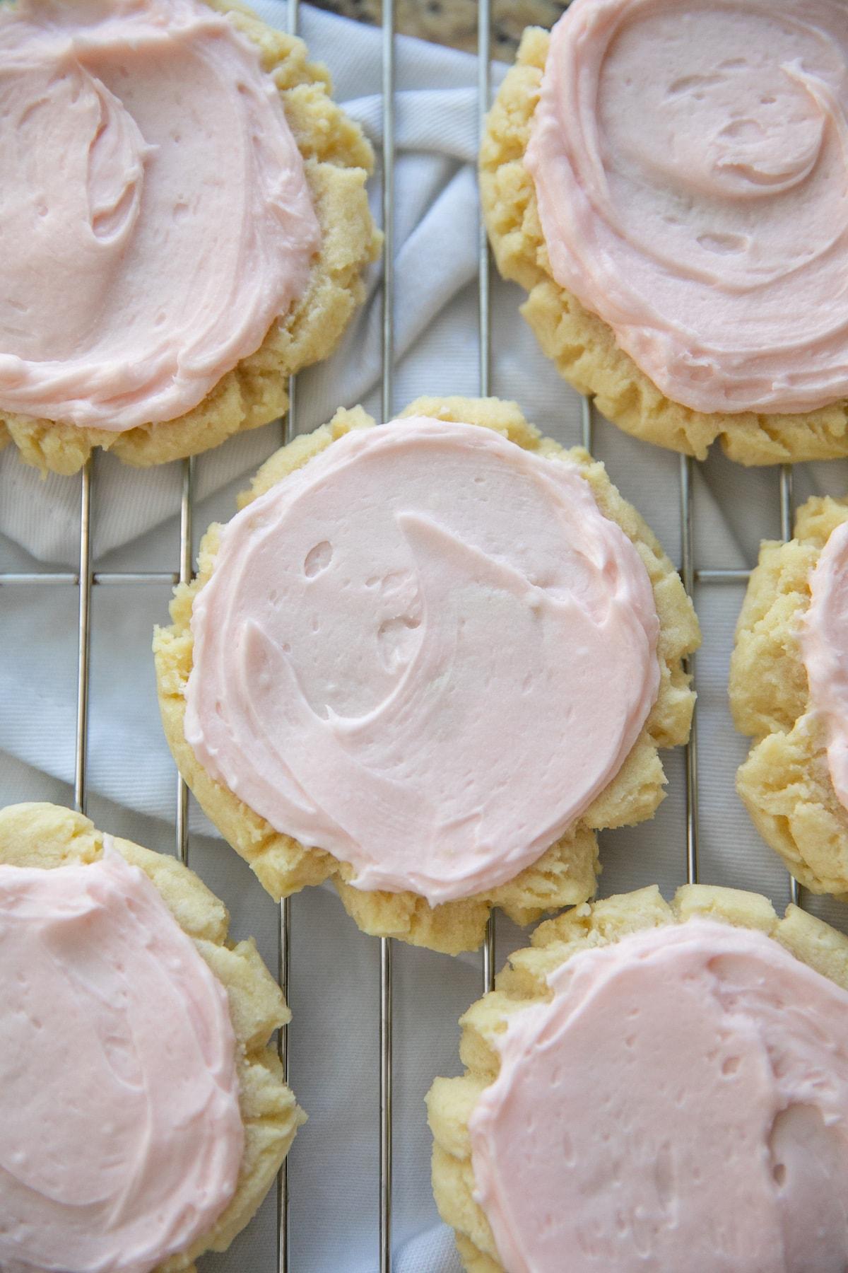 pressed sugar cookies on cooling rack