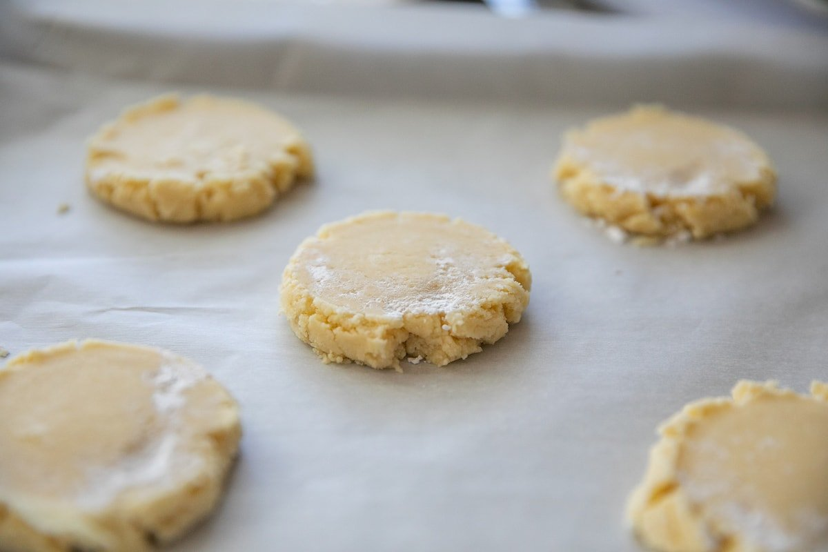 pressed cookie dough balls on baking sheet