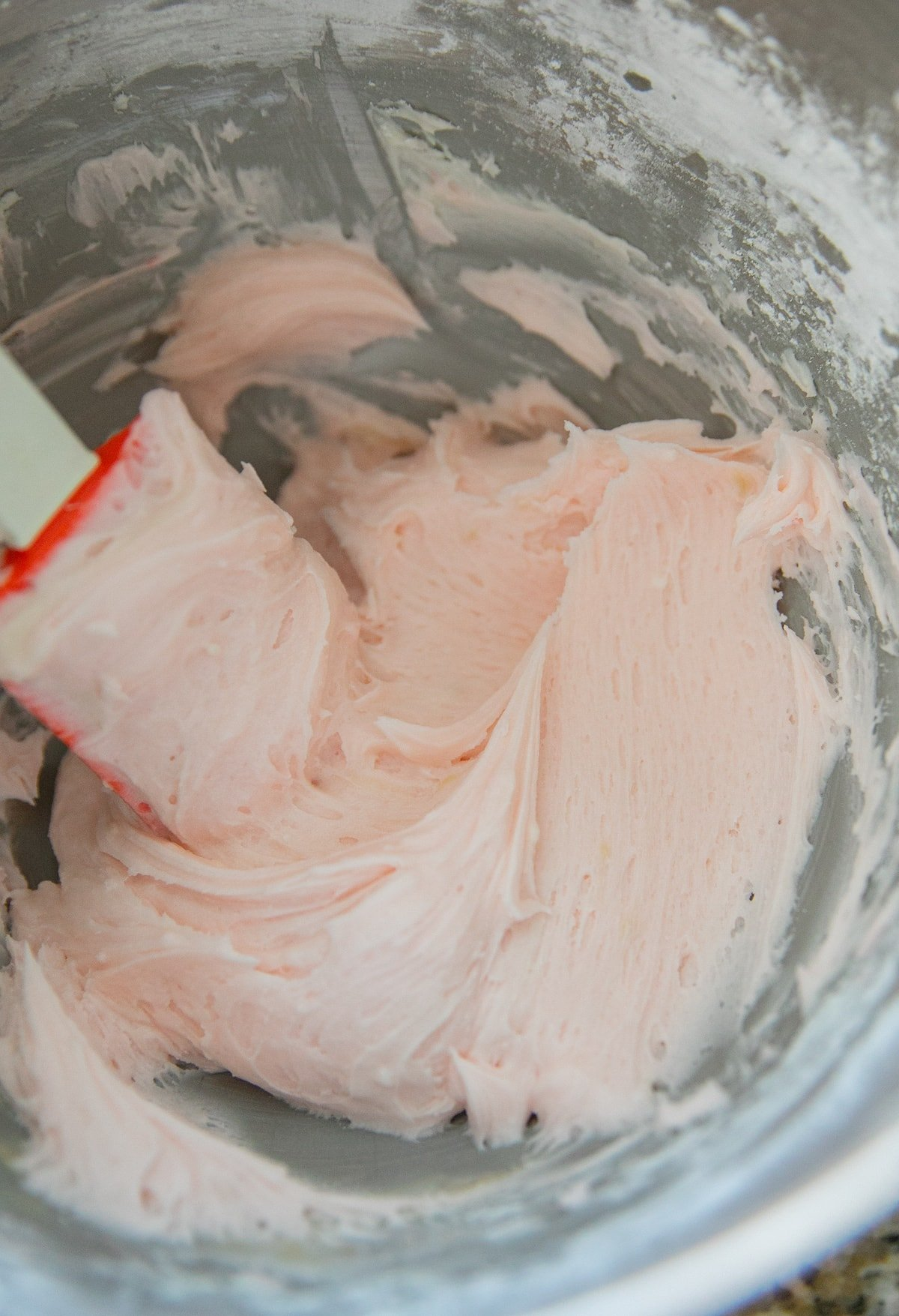 pink frosting in bowl