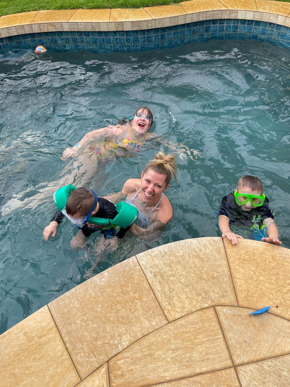 mom in pool with kids