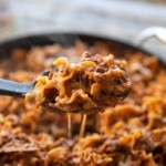 scooping skillet lasagna out of the pan