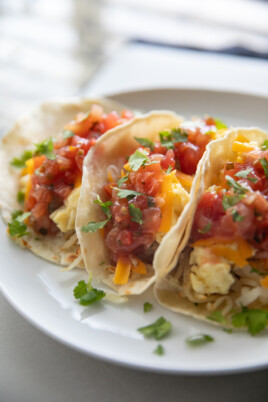 breakfast tacos on a white plate