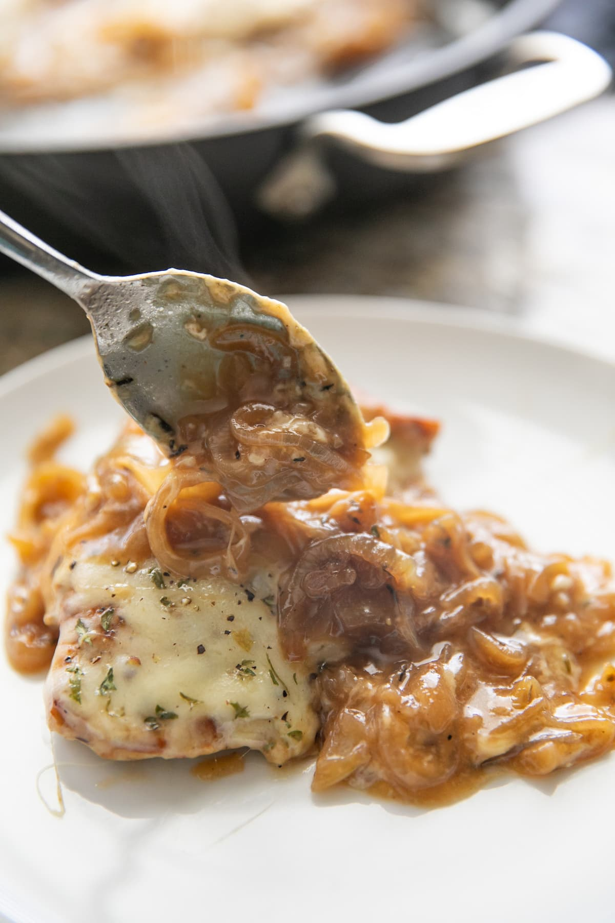 topping chicken breast with french onion mixture