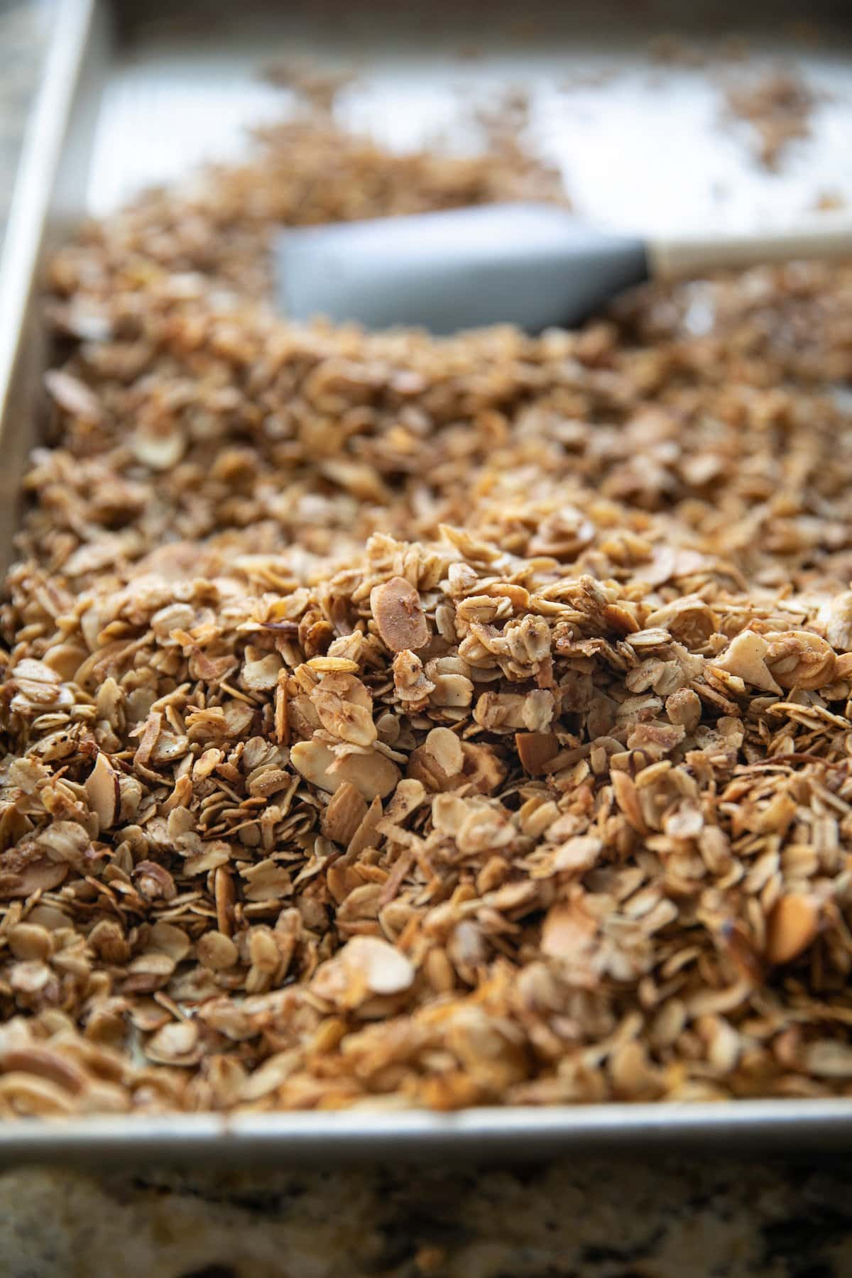 finished granola in a baking sheet