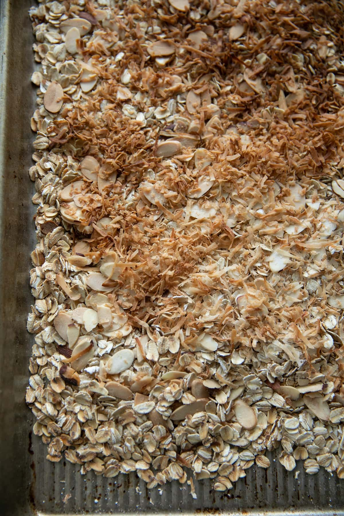 toasted coconut on top of other granola ingredients