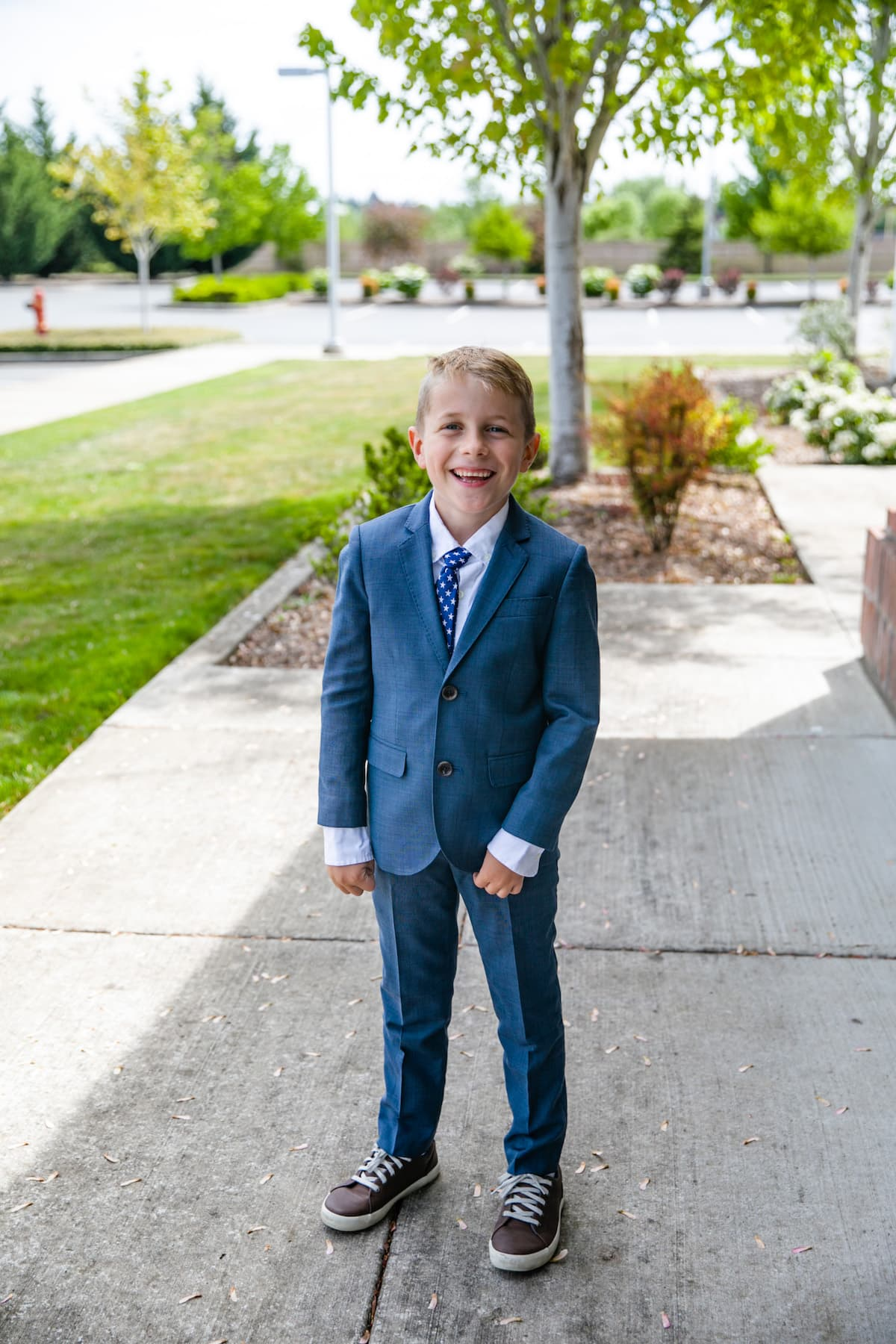 little boy standing and smiling