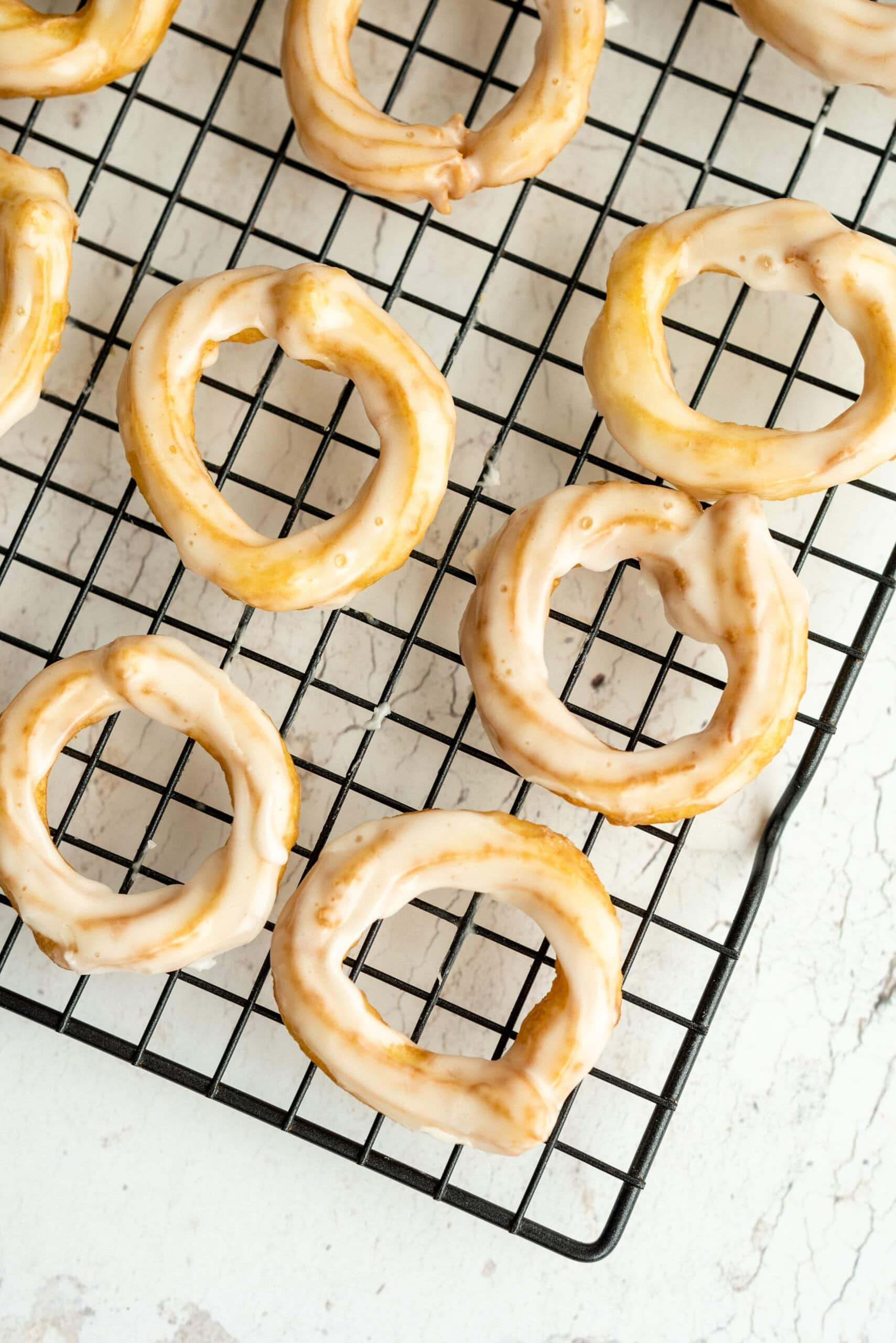 cruller donuts on a cooling wrack