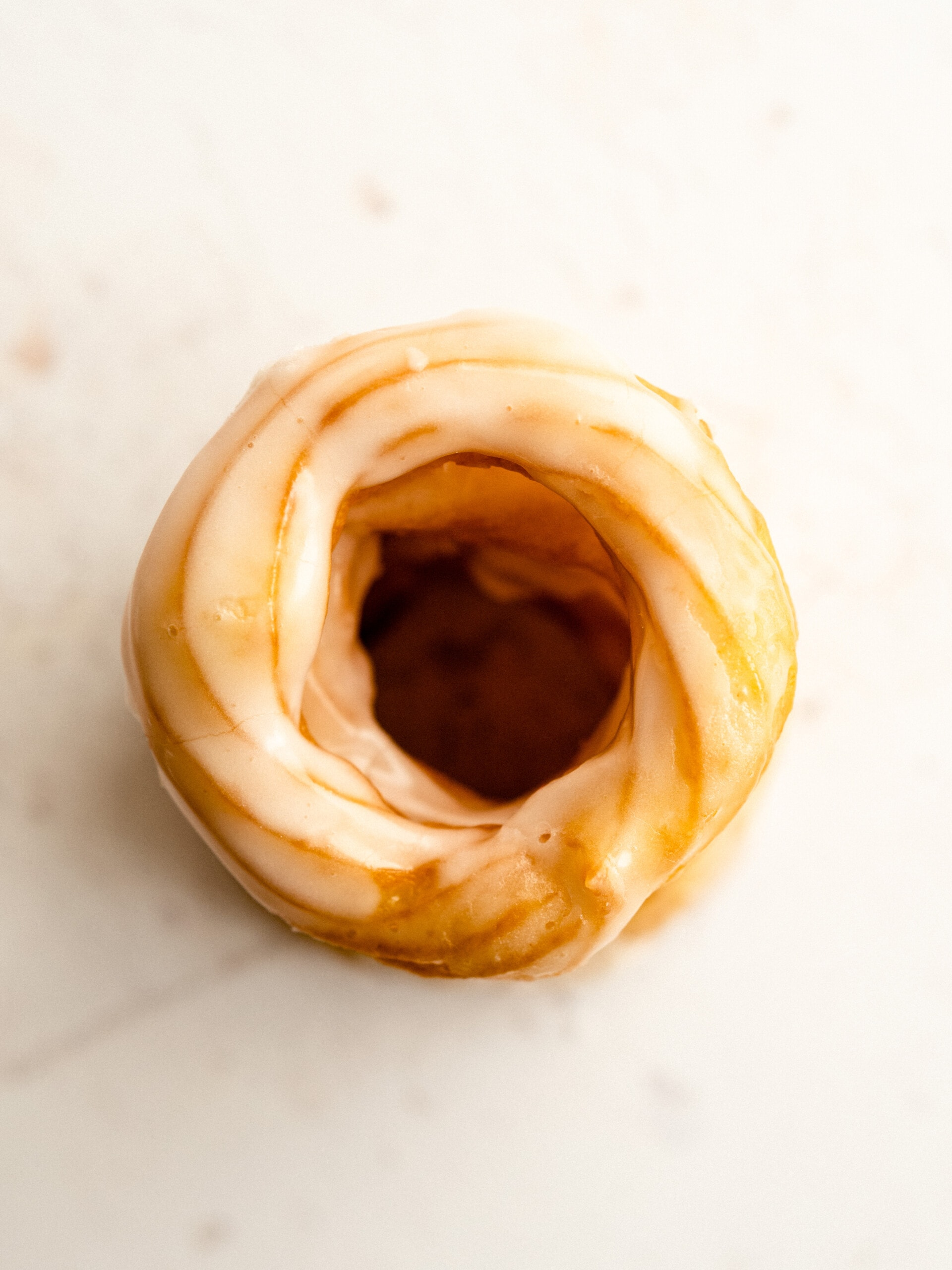 Top-down view of cruller donuts stacked on top of each other