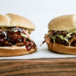 two pulled pork sandwiches photographed from the side