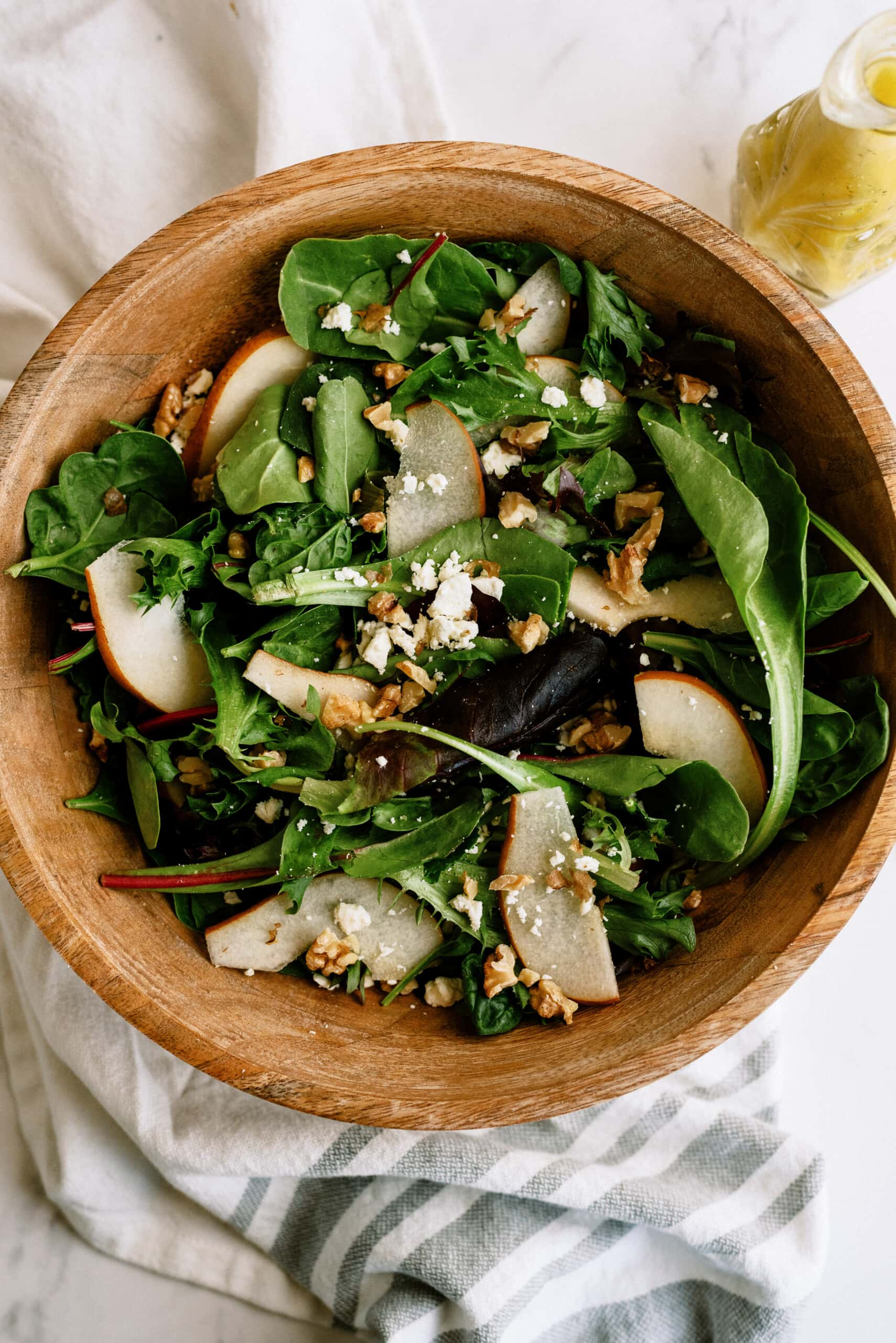 pear salad in wooden bowl