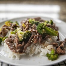 beef and broccoli over rice on plate