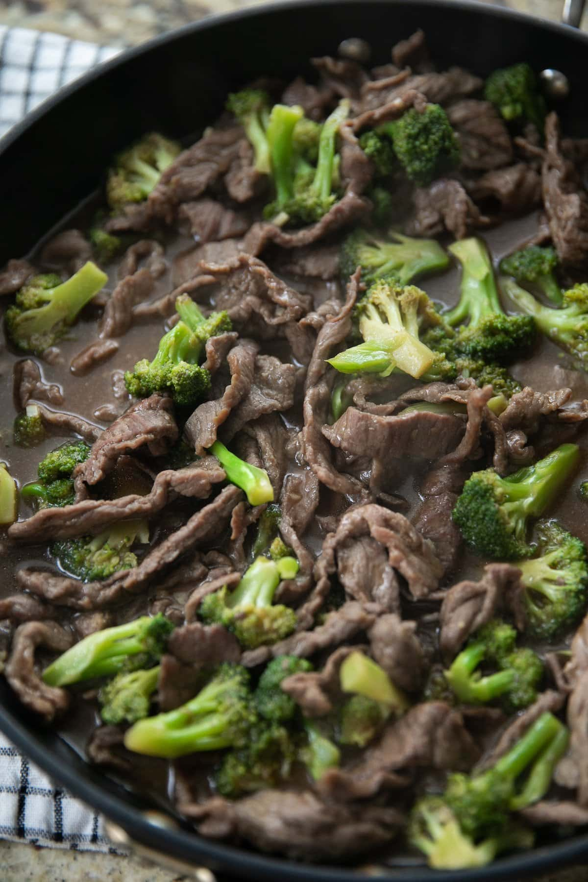 beef and broccoli in skillet