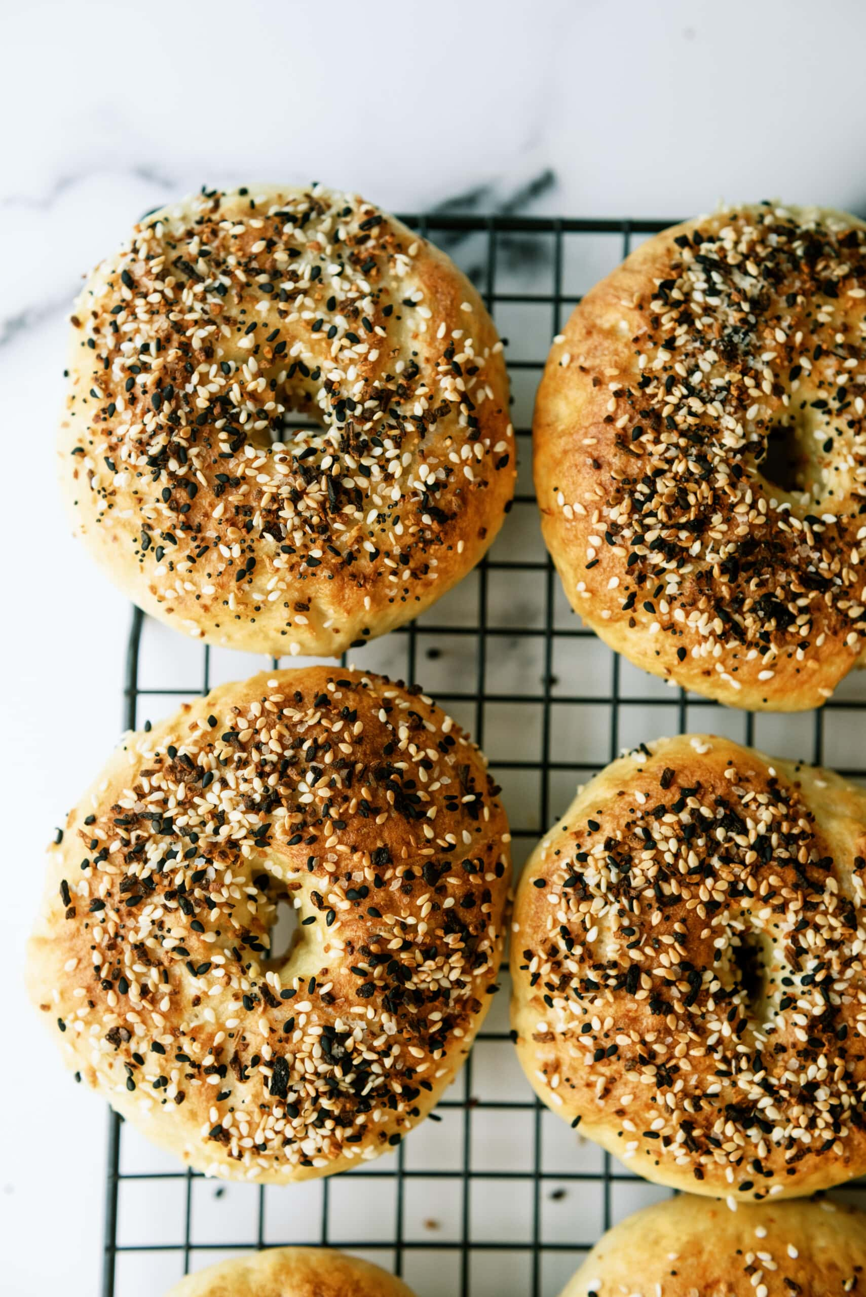 bagels with everything seasoning on a cooling wrack