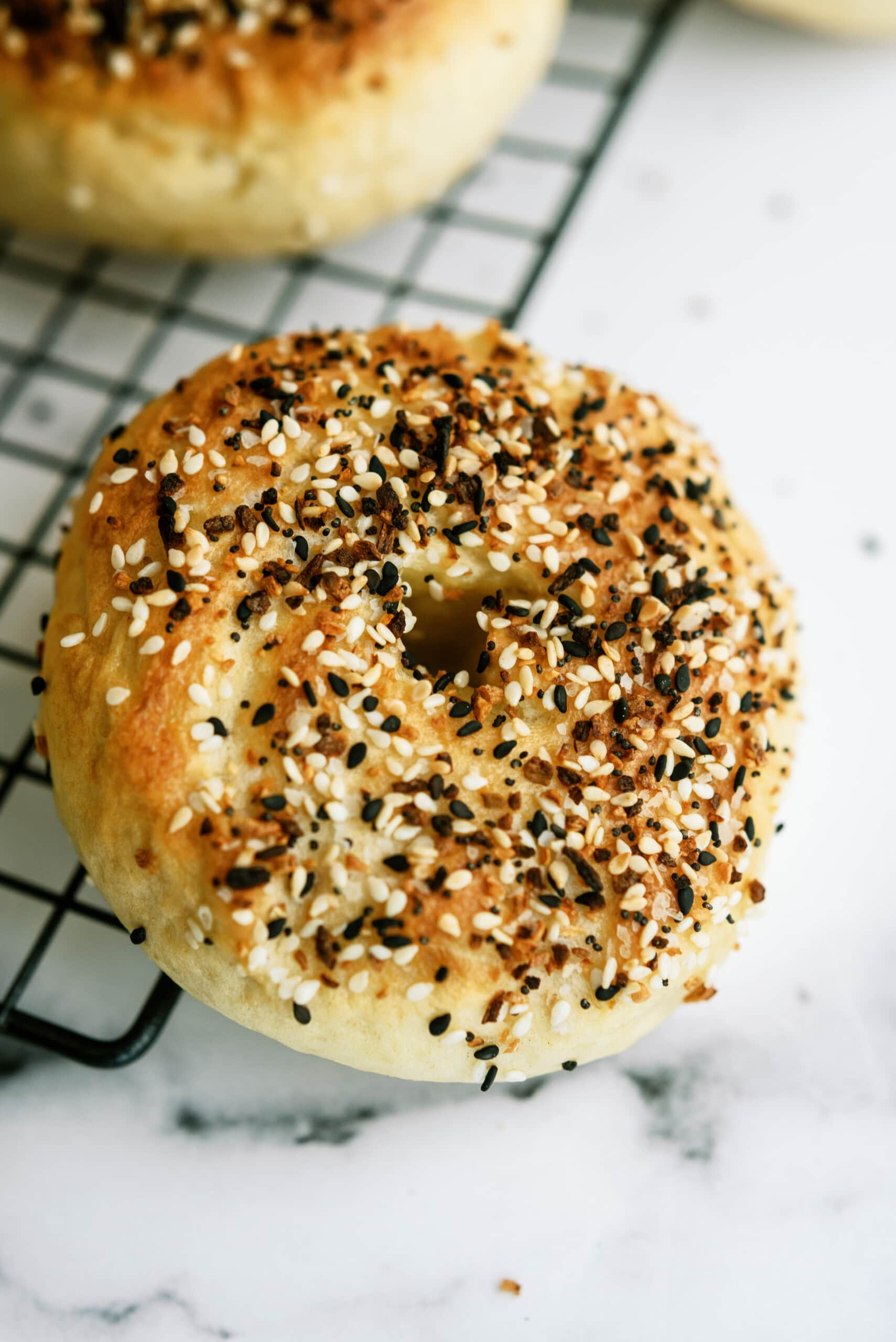 close up of a bagel with sesame seeds on it