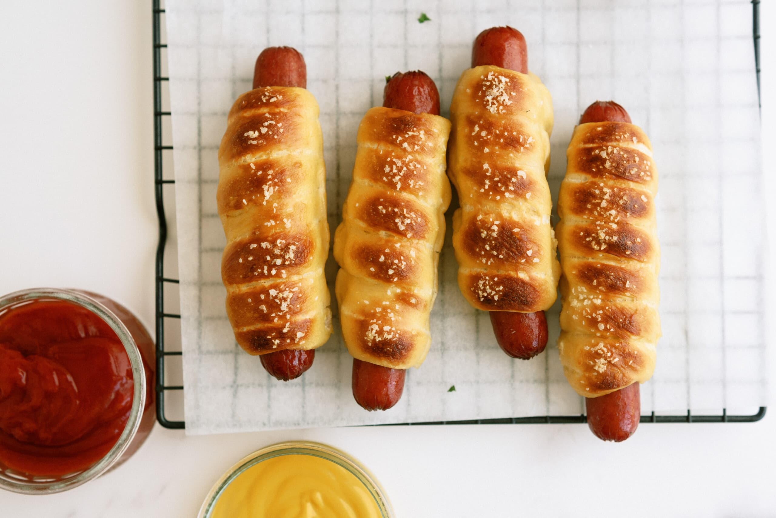 top down view of pretzel dogs on a cooling wrack