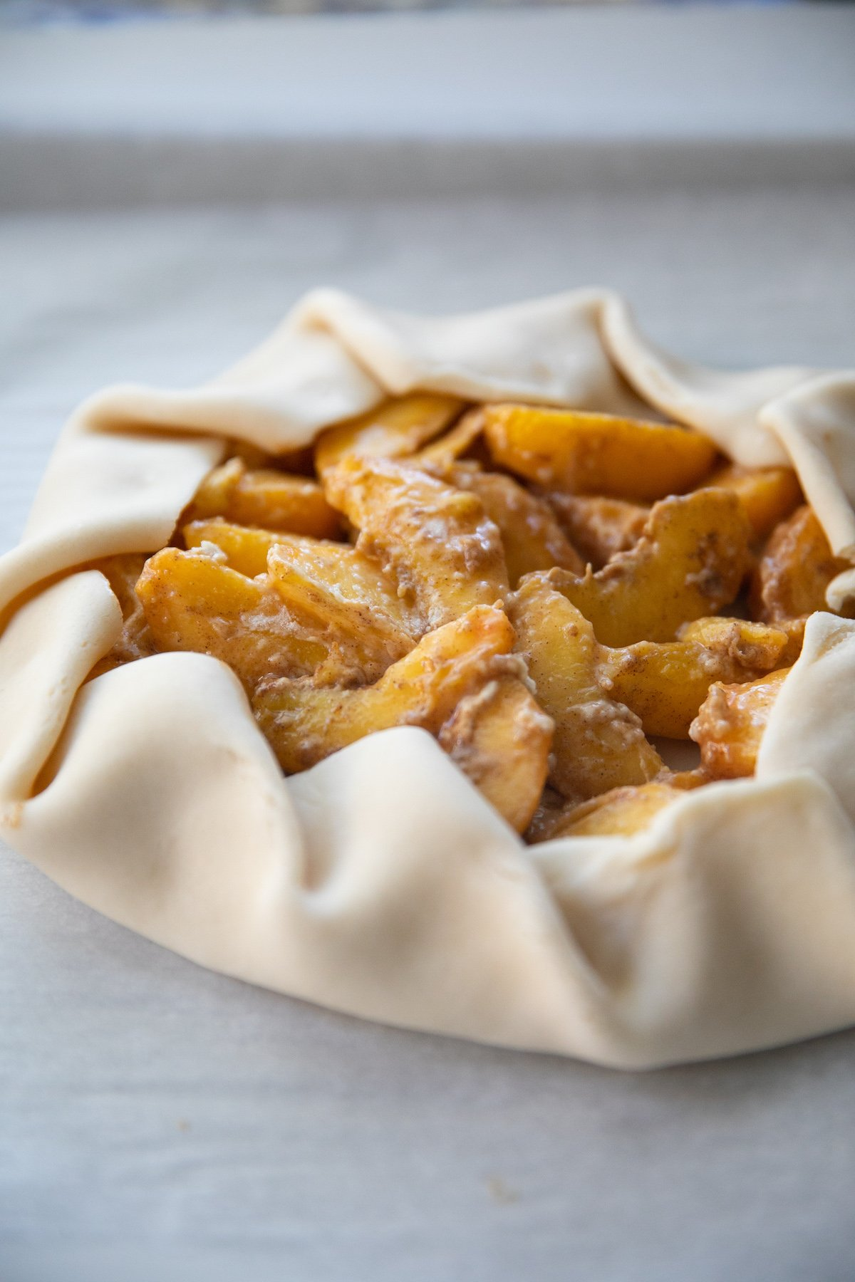 freshly folded up peach galette