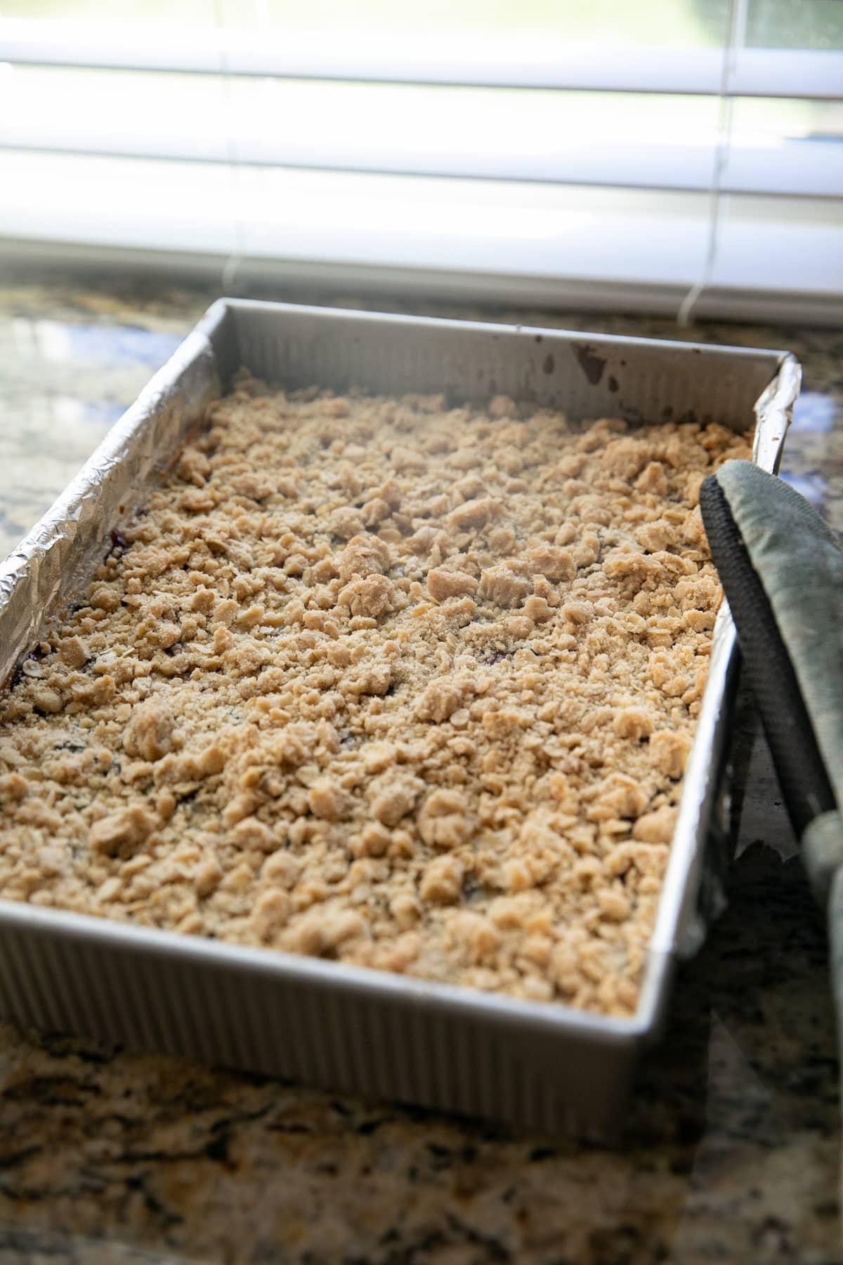 baked lemon blueberry bars in a baking pan
