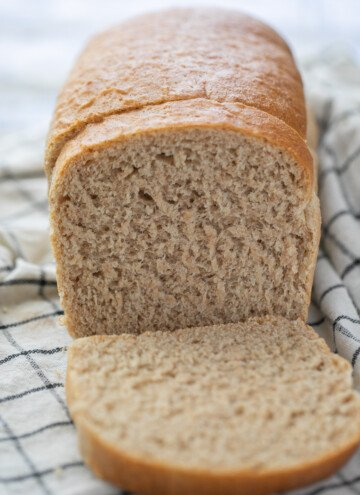 loaf of whole wheat bread with two slices