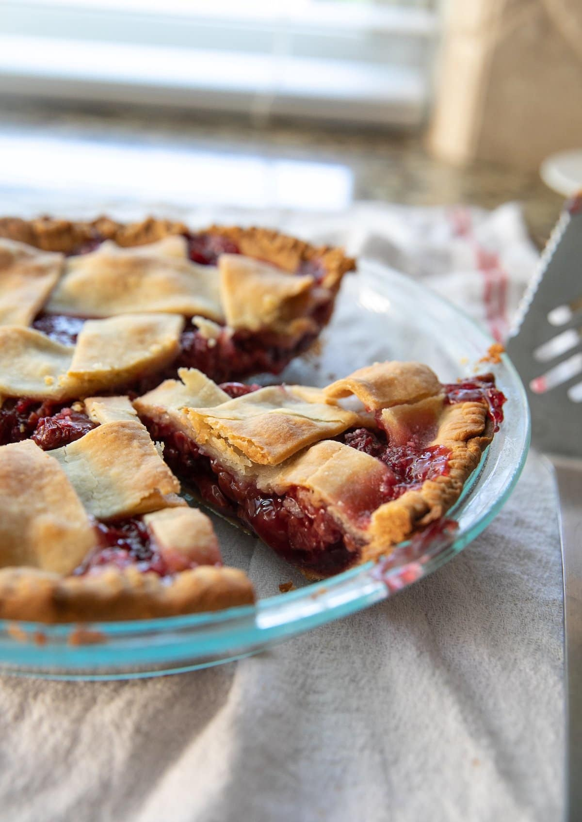 Sour cherry pie with slices taken from the pan