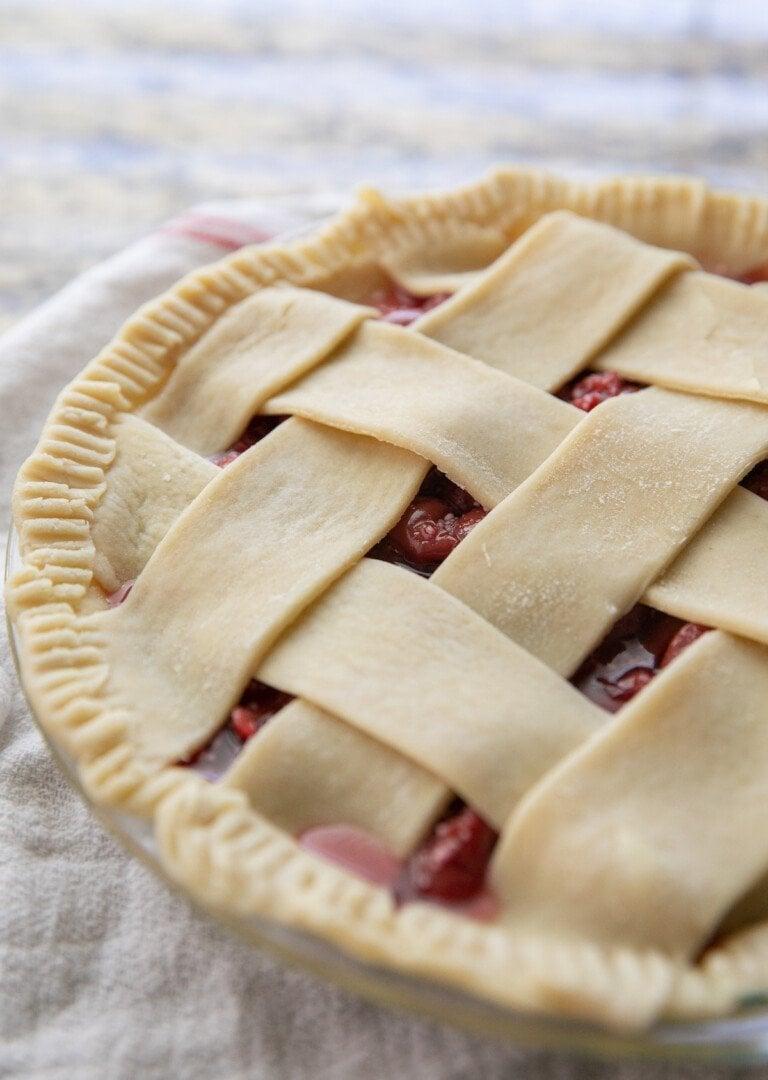 unbaked tart cherry pie with a lattice top