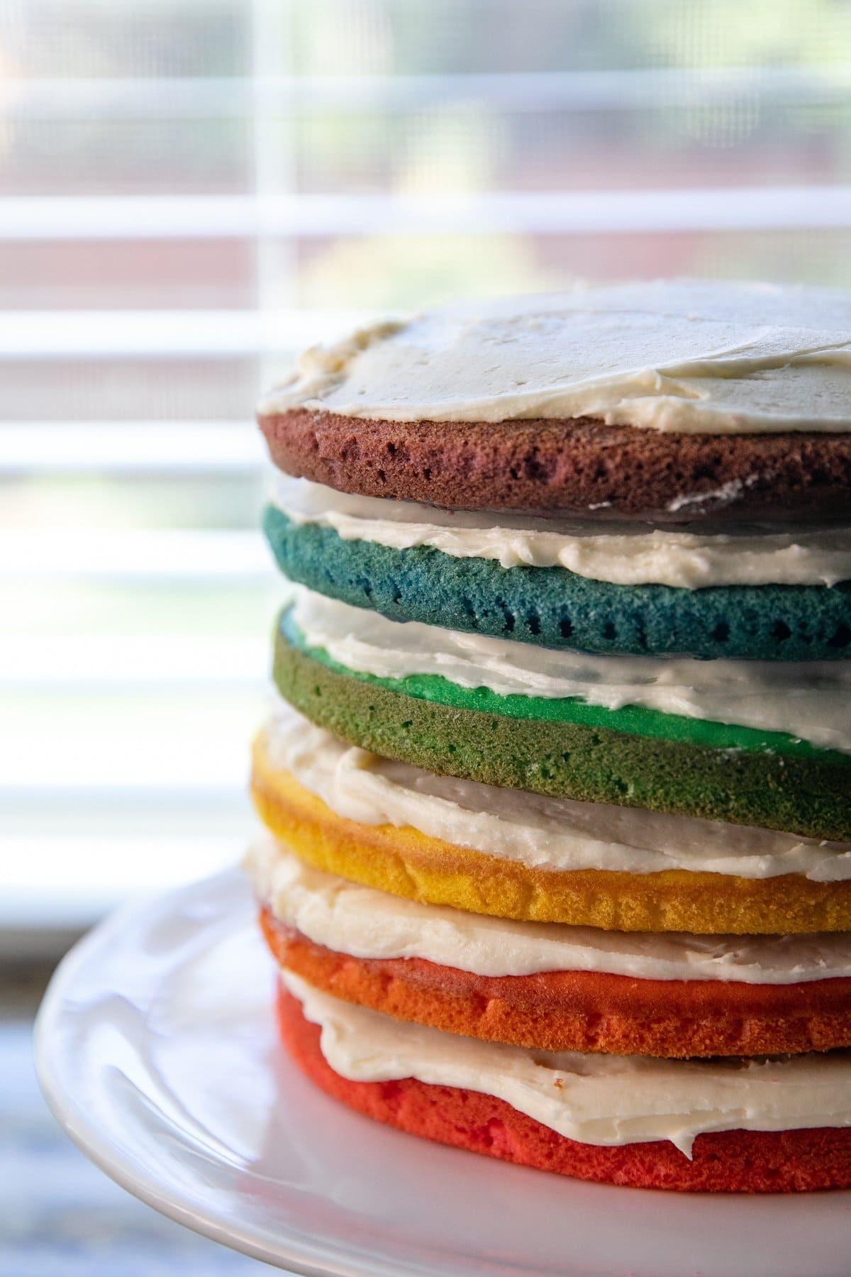 cake layers stacked with frosting in between them