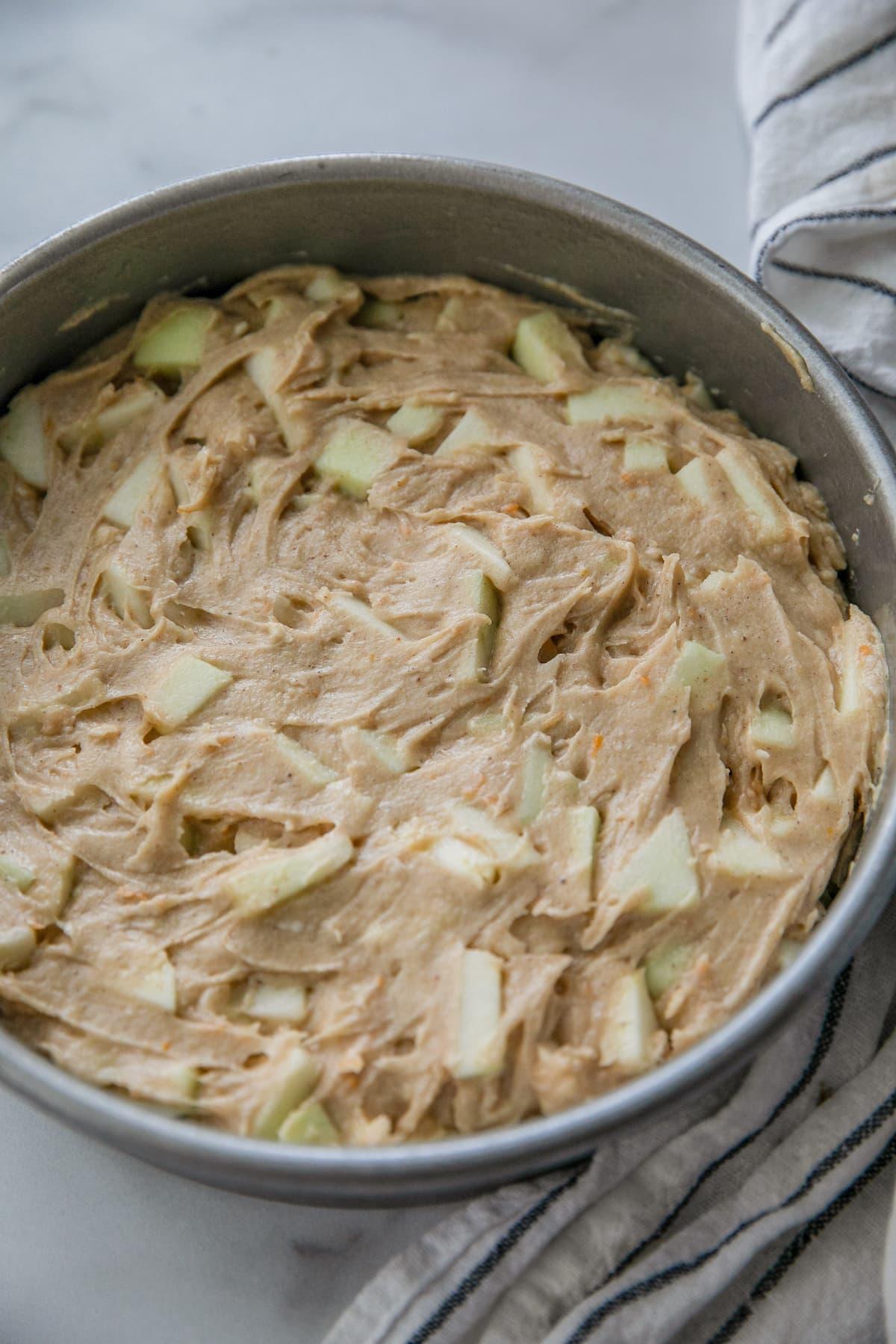 apple cake batter in round cake pan