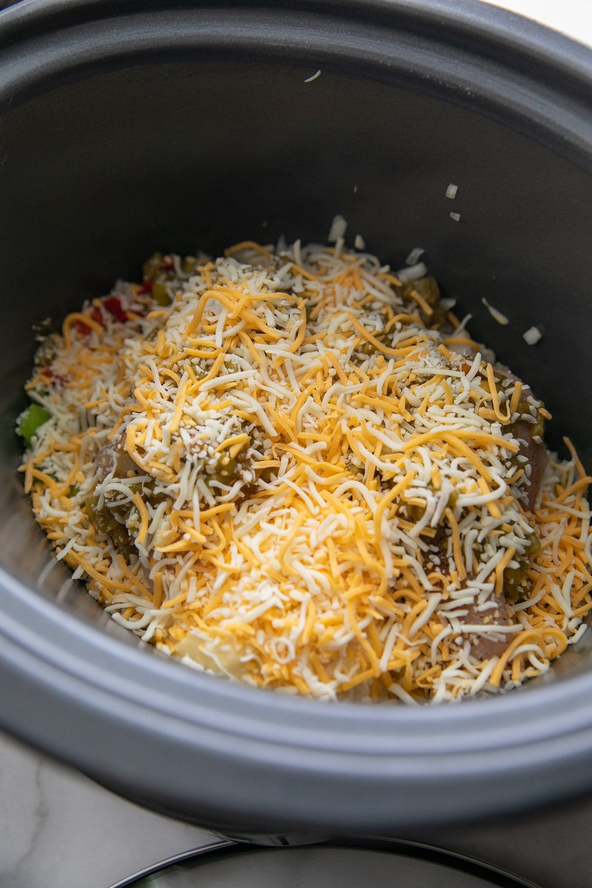 shredded cheese topping all other ingredients in a slow cooker