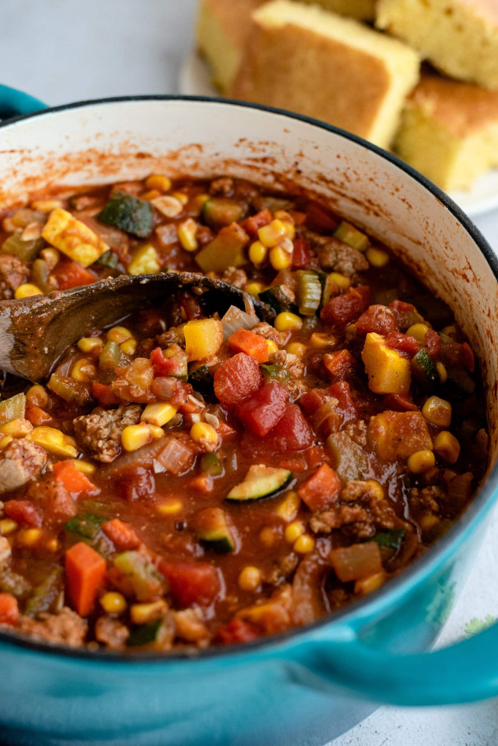scooping no bean chili from a pot
