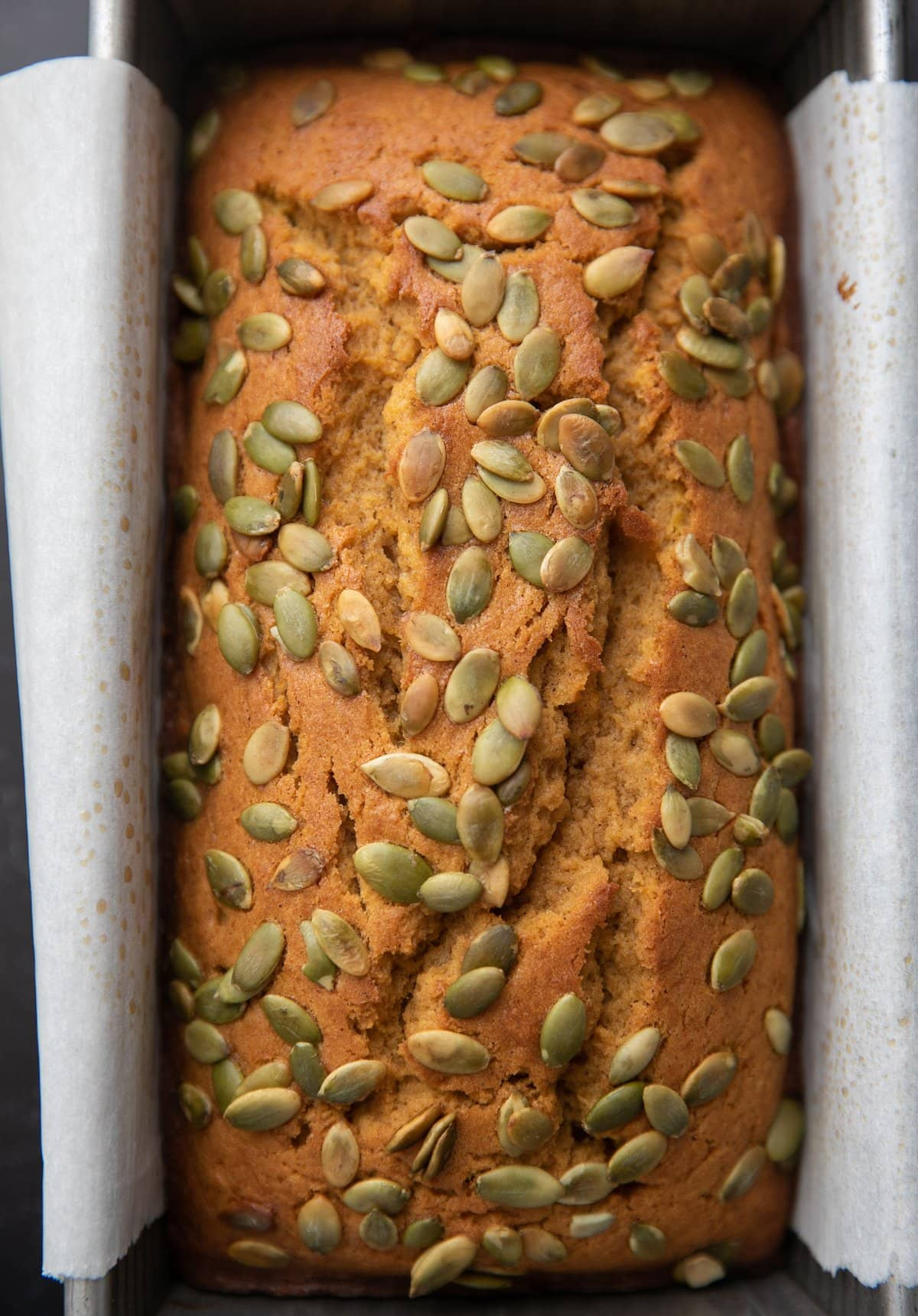 top down view of pumpkin bread in loaf pan