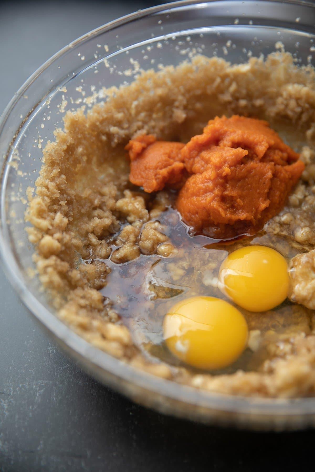 pumpkin puree, eggs, vanilla and sugar mixture, unmixed, in a glass bowl