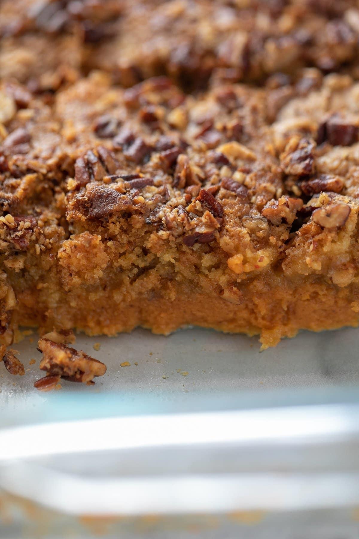 pumpkin crunch cake cut into pieces in pan