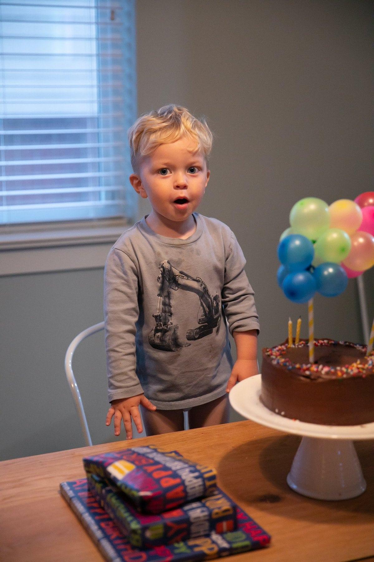 baby with chocolate birthday cake